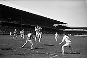 09/06/1963<br /> 06/09/1963<br /> 09 June 1963<br /> Kildare v Louth, Leinster Football quarter final at Croke park, Dublin. Harry fay, Kildare left full forward tackles Louth's J. Butterly in the air.