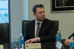 File photo - Tesla CEO Elon Musk is seen in attendance at a meeting of technology chiefs in the Trump Organization conference room at Trump Tower in New York, NY, USA on December 14, 2016. - Tech entrepreneur Elon Musk has revealed he has Asperger's syndrome while appearing on the US comedy sketch series Saturday Night Live (SNL). Photo by Albin Lohr-Jones / Pool via CNP