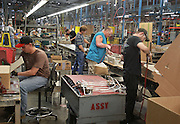 Empire Comfort Systems in Belleville is celebrating its 80th anniversary. Here, assembly line workers put together gas stove units.