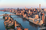 Aerial view of Roosevelt Island and the 59th Street Bridge showing midtown Manhattan, New York City in the background. Photographed at sunrise from a helicopter.