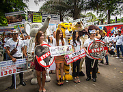 01 AUGUST 2013 - BANGKOK, THAILAND: Members of the Thai SPCA gather in front of the Parliament building. Members of the SPCAT picketed the Thai parliament building in Bangkok Thursday to call attention to proposed anti-animal cruelty laws being debated by the Parliament. The laws would tighten animal cruelty law regarding the dog (and cat) meat trade, buying and selling exotic pets, ivory and endangered animal products (like bear bile and ivory). Thailand serves as a transit point for the endangered animal and exotic meat trade. Ivory is shipped to China. Dogs (for meat) are sold to Vietnam.     PHOTO BY JACK KURTZ