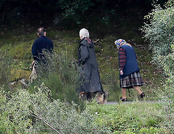 EXCLUSIVE HRH Queen Elizabeth II walks her dogs to a waiting car after having a family lunch in a lodge on the Balmoral Estate, 27 August 2018.<br /><br />9 September 2018.<br /><br />Please byline: ***NO BYLINE***