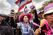 17 FEBRUARY 2014 - BANGKOK, THAILAND: Thai anti-government protestors gather in front of the Ministry of Education on Ratchadamnoen Avenue. The anti-government protest movement, led by the People's Democratic Reform Committee and called Shutdown Bangkok has been going on for more than a month. The protest movement called, the People's Democratic Reform Committee (PDRC), wants to purge the current ruling party and its patrons in the Shinawatra family from Thai politics. The movement has consistently refused any dialogue or negotiations with the Pheu Thai ruling party. Over the weekend Thai police claimed to have taken the protest areas around Government House (the Prime Minister's office) away from protestors but on Monday protestors marched unimpeded to Government House and retook the area.   PHOTO BY JACK KURTZ