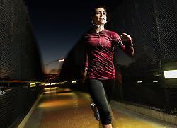 Woman running on pedestrian bridge (Credit Image: © Image Source/Corey Jenkins/Image Source/ZUMAPRESS.com)