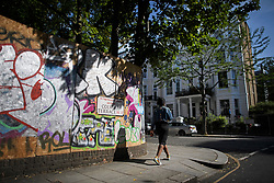 © Licensed to London News Pictures. 23/08/2019. London, UK. Graffiti covered boards protect residential properties as preparations begin ahead of the 2018 Notting Hill Carnival which starts this weekend. Warm weather is expected over the bank holiday weekend with carnival attracting over 1 million people to the capital. Photo credit: Ben Cawthra/LNP