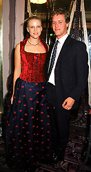 MISS SOPHIA BURRELL and MR PETER THOMPSON, at a fashion show in London on 3rd October 1999.MXB 79