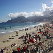 A beach scene looking along the stretch of beaches including Arpoador, Ipanema and Leblon beaches, from Pedra do Arpoador. Rio de Janeiro, Brazil. 4th July 2010. Photo Tim Clayton.