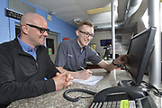 Chris Crowell, Managing Partner (left) and Steve Hamm, Tire Manager, at the Firestone Complete Auto Care facility in Clayton, MO, on Friday, April 12, 2019 in St. Louis. (Tim Vizer/AP Images for Bridgestone Retail Operations)