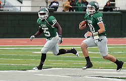 18 October 2014: Anfernee Roberts adds some blocking for Donovan Laible during an NCAA division 3 football game between the Augustana Vikings and the Illinois Wesleyan Titans in Tucci Stadium on Wilder Field, Bloomington IL
