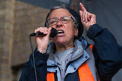 Southall, UK. 27th April 2019. Eve Turner of Ealing Trades Union Council and Ealing Save NHS addresses members of the local community and supporters at a rally outside Southall Town Hall to honour the memories of Gurdip Singh Chaggar and Blair Peach on the 40th anniversary of their deaths. Gurdip Singh Chaggar, a young Asian boy, was the victim of a racially motivated attack whist Blair Peach, a teacher, was killed by the Metropolitan Police's Special Patrol Group during a peaceful march against a National Front demonstration.