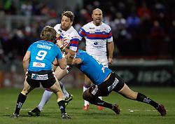 Wakefield Trinity's Danny Kirmond is tackled by Salford Red Devils' Luke Burgess (right) and Logan Tomkins during the Betfred Super League match at Belle Vue Stadium, Salford.