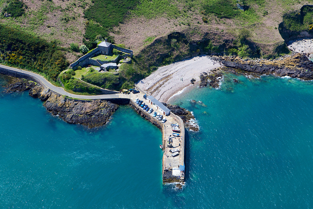 Aerial view of the Heritage property and accommodation, Fort Leicester, and the pier and beach at Bouley Bay, with its crystal clear, turquoise water in Jersey, Channel Islands