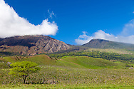 Maui, Hawaii. The Kaupo Gap with the peak of Haleakala obscured by afternoon clouds.