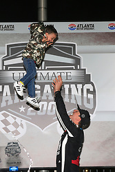 February 23, 2019 - Hampton, GA, U.S. - HAMPTON, GA - FEBRUARY 23:  Kyle Busch and his son, Brexton, celebrate winning the 11th running of the Ultimate Tailgating 200 NASCAR Gander Outdoors Truck Series race on February 23, 2019 at the Atlanta Motor Speedway in Hampton, GA.  (Photo by David J. Griffin/Icon Sportswire) (Credit Image: © David J. Griffin/Icon SMI via ZUMA Press)