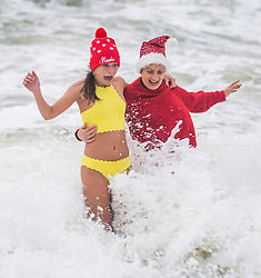 © Licensed to London News Pictures. 25/12/2017. Brighton, UK. 23 year old BETH COOPER and mother, 57 year old ROSIE MARTIN take part in the 2017 Christmas Day Swim in Brighton and Hove.Photo credit: Hugo Michiels/LNP