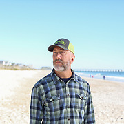 Wrightsville Beach, NC - October, 23 2016: David Jacobs stands on the beach outside his home on Wrightsville Beach. Currently sea level rise projections are expected to affect his home. CREDIT: LOGAN R CYRUS FOR THE NEW YORK TIMES