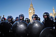 London, England, 15/09/2004..An estimated 20,000 hunt supporters demonstrate in Parliament Square as a new bill to ban hunting with dogs is passed. Some demonstrators fought with riot police, and five hunt supporters managed to get onto the House of Commons floor during the debate..Police in riot gear defend parliament Square from demonstrators.