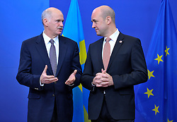 George Papandreou, Greece's prime minister, left, arrives for the European Union Summit and is greeted by Fredrik Reinfeldt, Sweden's prime minister and standing president of the European Council, at the EU headquarters in Brussels, Belgium, on Thursday, Nov. 19, 2009. European leaders will try to set divisions aside today as they choose their first-ever European Union president to represent the 27-nation bloc on the world stage.  (Photo © Jock Fistick).