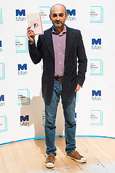 © Licensed to London News Pictures. 16/10/2017. London, UK.  UK-Pakistan author MOSHIN HAMID with his book Exit West attends the Man Booker prize for fiction shortlisted event at the Royal festival Hall. The winning author will receive £50,000 prize money.Photo credit: Ray Tang/LNP