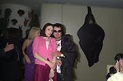 Tessa Dahl and Nicky Haslam. Talk pre-Bafta party. St. Martin's Lane Hotel. London. 24 February 2001. © Copyright Photograph by Dafydd Jones 66 Stockwell Park Rd. London SW9 0DA Tel 020 7733 0108 www.dafjones.com