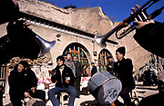 Wedding party band play in the village of Chang Qu outside a cave house (dwelling), Shaanxi, China