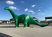 Old fashioned statue of a dinosaur at a Sinclair gas station, Green River, Utah, Arkansas