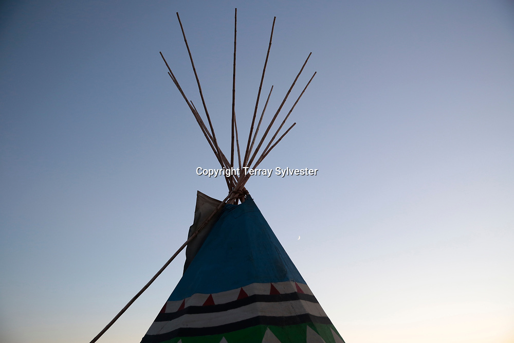 A tipi catches the evening light in the opposition camp against the Dakota Access oil pipeline on October 4, 2016. Cannon Ball, North Dakota, United States.