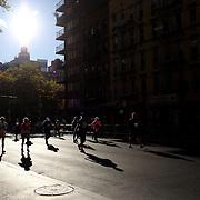Runners make their way along First Avenue in Manhattan, New York, during the ING New York Marathon. New York, USA. 3rd November 2013. Photo Tim Clayton