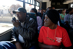 30 Oct, 2005.  New Orleans, Louisiana. Hurricane Katrina aftermath.<br /> Riding on the Gray Line bus tour for residents of the Lower 9th ward. Unlike the nearby predominantly white neighbourhoods, residents can only visit the area on special busses and are not permitted to get off the bus except at one designated location to view a 'typical' house. L/R Earl Odems speaks to his father on the phone to tell him his home is destroyed. Next to him 85 yr old Rosalie Robinson is stunned at the devastation.<br /> Photo; ©Charlie Varley/varleypix.com