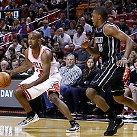 29 January 2012: Chicago Bulls point guard John Lucas (15) drives past Miami Heat point guard Mario Chalmers (15) during the Miami Heat 97-93 victory over the Chicago Bulls at the AmericanAirlines Arena, Miami, Florida, USA.