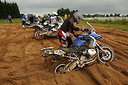 Bill Dragoo from Oklahoma (foreground) competes with five other contestants during the BMW GS Trophy Challenge held at the BMW Performance and Test Center in Spartanburg, SC.  Contestants had to race against each other to free their 2008 RS1200GS from the deep sugar sand and ride the 600lb motorcycle out of the sand pit.