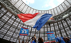 France fans wave flags in the build-up to the game