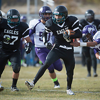 111514      Cayla Nimmo<br /> <br /> Navajo Prep Eagle Dante Alonzo (8) runs past a Santa Rosa player during the first playoff game held in Farmington on Saturday.