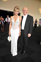 JOHN CAUDWELL and CLAIRE JOHNSON at The Butterfly Ball in aid of the Caudwell Children Charity held in Battersea park, London on 14th May 2009.