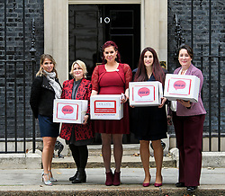 © Licensed to London News Pictures. 08/10/2018. Labour MP LUCIANA BERGER (2R) is joined by campaigner NATASHA DEVON (Centre) and other campaigners as they hand the Mental Health First Aid England petition titled 'Where's Your Head At?', at the front door of 10 Downing Street, calling for a law change. Photo credit: Ben Cawthra/LNP
