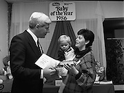 Heinz / Woman's Way, Baby of the Year..1986..21.11.1986..11.21.1986..21st November 1986..The 19th Annual 'Baby of the Year' awards ceremony took place at the Zoological Gardens,Dublin..Baby, Alan Smith from Co Meath was the overall winner.Amy Dempsey from Dublin and Brendan Gallagher from Waterford were placed 2nd and 3rd...Picture shows Mr John Paul O'Reilly, Heinz, presenting the Leinster Regional Award to Jenna Louise Cahill. Jenna is accompanied by her mother Geraldine from Portlaoise,Co Laois.