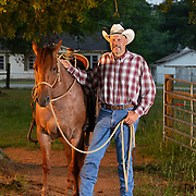 """Keven Thompson stands with his horse """"Frist"""" before rounding up cattle at the Middle Tennessee Research and Eduction Center in Spring Hill. Thompson has developed a cow-herd management program using horses. Nathan Lambrecht/Journal Communications"""