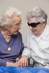 Two ladies sitting and talking at the Nottingham Royal Society for the Blind (NRSB),