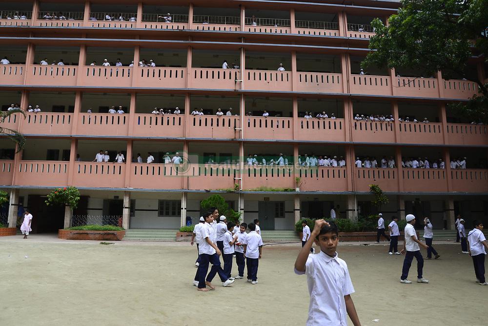 July 23, 2017 - Dhaka, Bangladesh - Bangladeshi school students walking on the school ground at class break time in Dhaka city, Bangladesh on July 23, 2017. (Credit Image: © Str/NurPhoto via ZUMA Press)