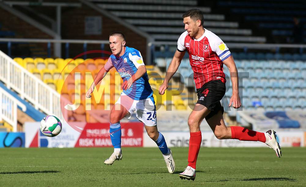 Flynn Clarke of Peterborough United in action with Ben Tozer of Cheltenham Town - Mandatory by-line: Joe Dent/JMP - 05/09/2020 - FOOTBALL - Weston Homes Stadium - Peterborough, England - Peterborough United v Cheltenham Town - Carabao Cup