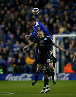 Photo: Steve Bond/Richard Lane Photography. Leicester City v Peterborough United. Coca-Cola Football League One. 20/12/2008. Aleksandar Tunchev gets well above Andrew Crofts