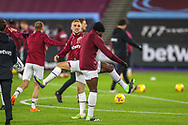 Jarrod Bowen (20) of West Ham United and Michail Antonio (30) of West Ham United warm up during the Premier League match between West Ham United and West Bromwich Albion at the London Stadium, London, England on 19 January 2021.