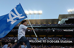 October 24, 2017 - Los Angeles, California, U.S. - Actor Ken Jeong waves Dodger flag prior to game one of a World Series baseball game between the Houston Astros and the Los Angeles Dodgers at Dodger Stadium on Tuesday, Oct. 24, 2017 in Los Angeles. (Photo by Keith Birmingham, Pasadena Star-News/SCNG) (Credit Image: © San Gabriel Valley Tribune via ZUMA Wire)