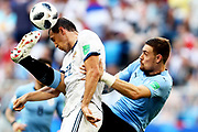 Sebastian Coates of Uruguay tackles Artem Dzyuba of Russia during the 2018 FIFA World Cup Russia group A match between Uruguay and Russia at Samara Arena on June 25, 2018 in Samara, Russia.