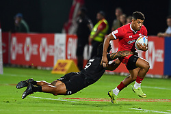 Rio Dyer of Wales is tackled by Dylan Collier of New Zealand <br /> <br /> Photographer Craig Thomas/Replay Images<br /> <br /> World Rugby HSBC World Sevens Series - Day 1 - Thursday 5rd December 2019 - Sevens Stadium - Dubai<br /> <br /> World Copyright © Replay Images . All rights reserved. info@replayimages.co.uk - http://replayimages.co.uk