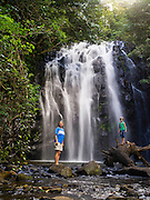 A boy and his mother at the base of Ellinjaa Falls, in the Atherton Tablelands of Queensland, Australia.