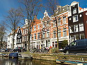 A view along one of Amsterdam's many canals on a beautiful spring day.