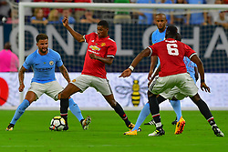 Manchester United defender Chris Smalling (12) takes possession during the International Champions Cup match between Manchester United and Manchester City at NRG Stadium in Houston, Texas