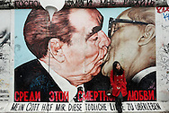 'My God, help me to survive this deadly love'. Painting by Dmitri Vrubel on a remaining section of the Berlin Wall at East Side Gallery, of Leonid Brezhnev and Erich Honecker kissing. Berlin, Germany (9 November 2014). 9 November 2014 marked the 25th anniversary of the fall of the Berlin Wall, and on the preceding day some 8,000 large white illuminated balloons were placed along the course of the former Wall, to be released in the evening on 9 November. © Rudolf Abraham.