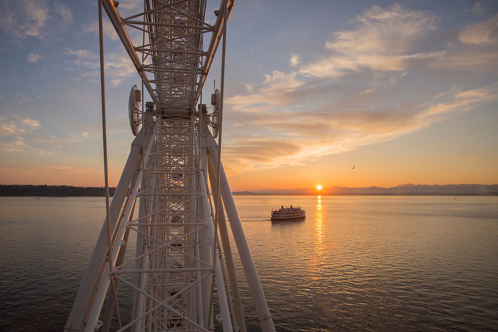 """United States, Washington, Seattle, """"Great Wheel"""" ferris wheel, Elliott Bay, a ferry, and the Olympic Mountains at sunset"""